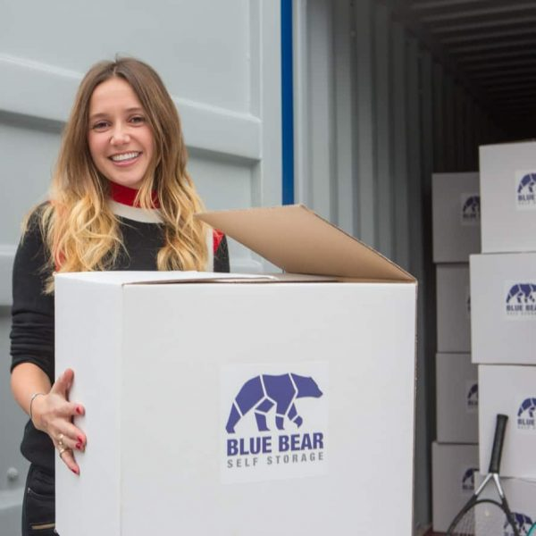 Self Storage with Blue Bear. Girl holding a boc at our corby self-storage facility